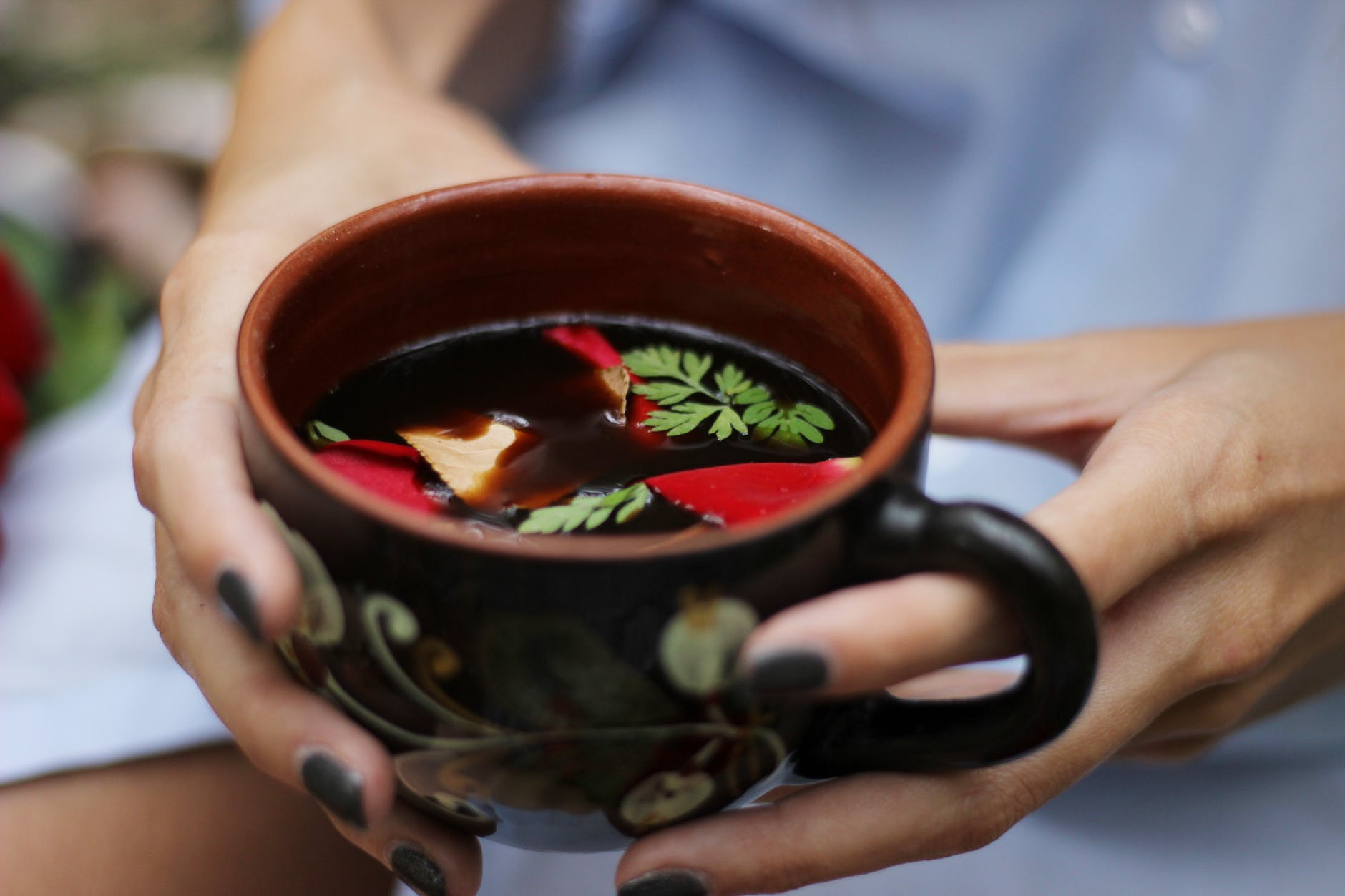 person holding a teacup